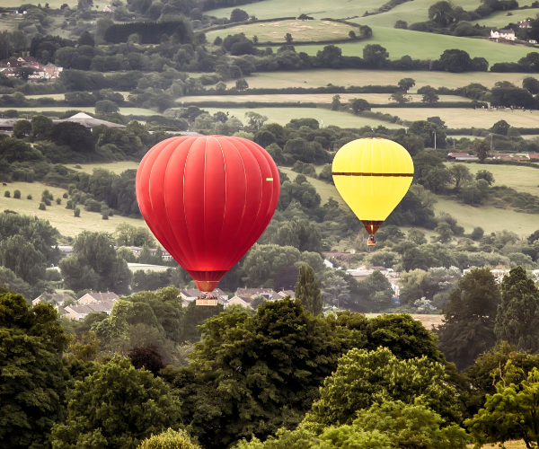 yellow and red air balloons in air