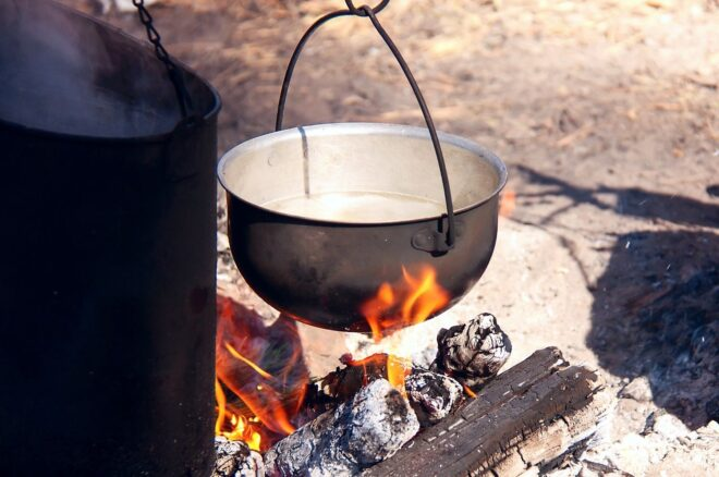 pot bowling over fire at campsite