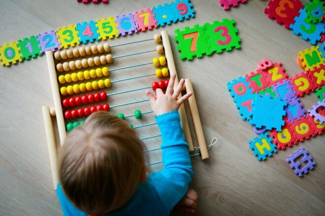 Toddler demonstrated Milestones by playing counting and numbers