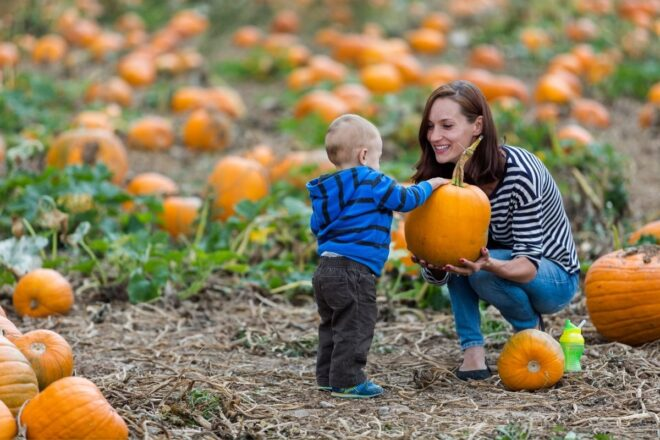 Mom and baby with pumpkin